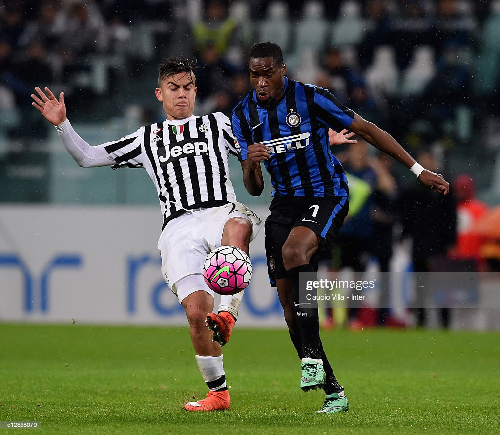 Geoffrey Kondogbia of FC Internazionale and Paulo Dybala of Juventus (L) compete for the ball during the Serie A match between Juventus FC and FC Internazionale Milano at Juventus Arena on February 28, 2016 in Turin, Italy.