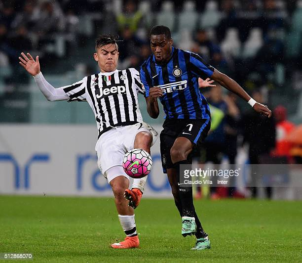 Geoffrey Kondogbia of FC Internazionale and Paulo Dybala of Juventus compete for the ball during the Serie A match between Juventus FC and FC...