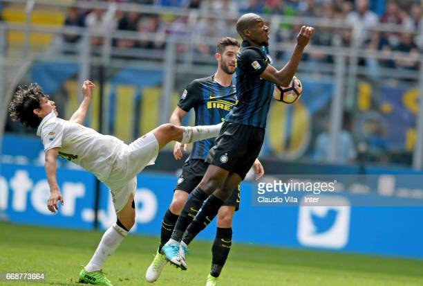 Geoffrey Kondogbia of FC Internazionale competes for the ball with Matias Fernandez of AC Milan during the Serie A match between FC Internazionale...