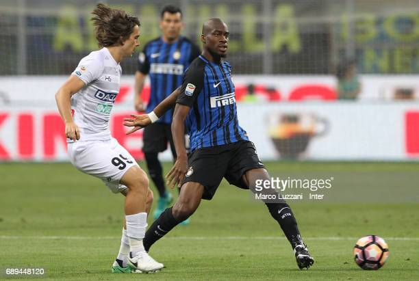 Geoffrey Kondogbia of FC Internazionale competes for the ball with Andrija Balic of Udinese Calcio during the Serie A match between FC Internazionale...