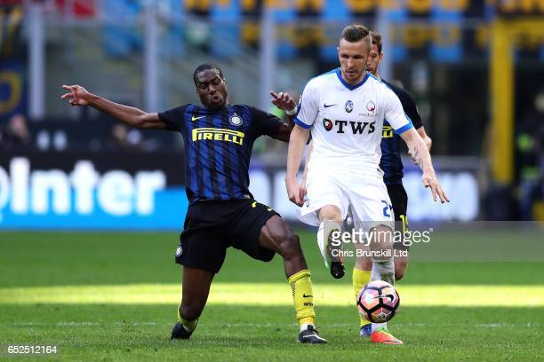 Geoffrey Kondogbia of FC Internazionale in action with Andrea Conti of Atalanta BC during the Serie A match between FC Internazionale and Atalanta BC...