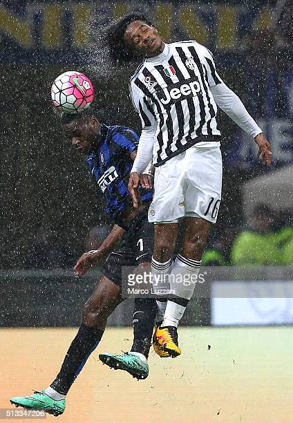 Geoffrey Kondogbia of FC Internazionale Milano competes for the ball with Juan Cuadrado of Juventus FC during the TIM Cup match between FC...