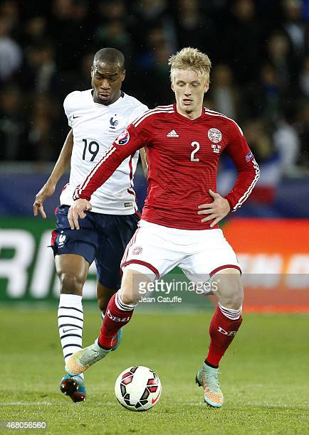 Geoffrey Kondogbia of France and Daniel Wass of Denmark in action during the international friendly match between France and Denmark at Stade...