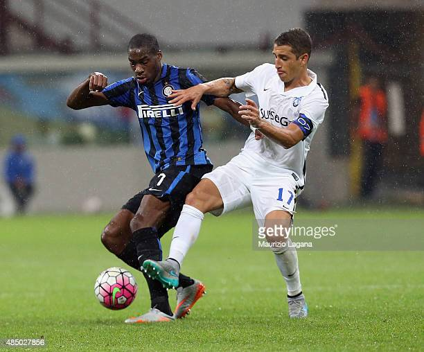 Geoffrey Kondogbia of Inter competes for the ball with Carlos Carmona of Atalanta during the Serie A match between FC Internazionale Milano and...