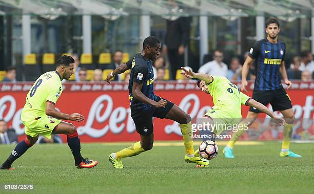 Geoffrey Kondogbia of Inter competes for the ball with Vasilis Torosidis of Bologna during the Serie A match between FC Internazionale and Bologna FC...