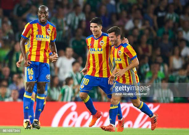 Geoffrey Kondogbia of Valencia CF celebrates after scoring during the La Liga match between Real Betis and Valencia at Estadio Benito Villamarin on...