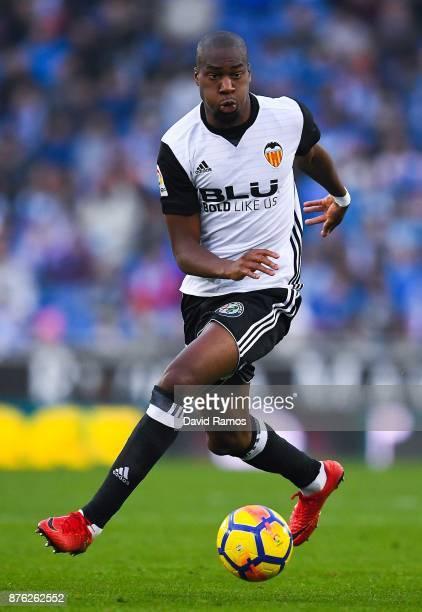 Geoffrey Kondogbia of Valencia CF runs with the ball during the La Liga match between Espanyol and Valencia at Cornella El Prat stadium on November...