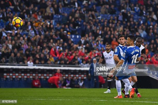 Geoffrey Kondogbia of Valencia CF scores the opening goal past Pablo Piatti and Javi Fuego of RCD Espanyol during the La Liga match between Espanyol...