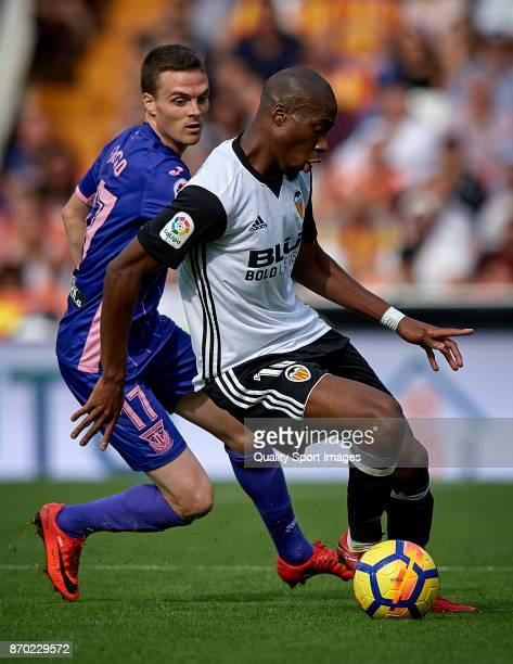 Geoffrey Kondogbia of Valencia competes for the ball with Javier Eraso of Leganes during the La Liga match between Valencia and Leganes at Mestalla...