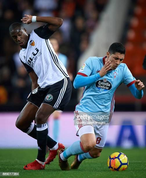 Geoffrey Kondogbia of Valencia competes for the ball with Pablo Hernandez of Celta de Vigo during the La Liga match between Valencia and Celta de...