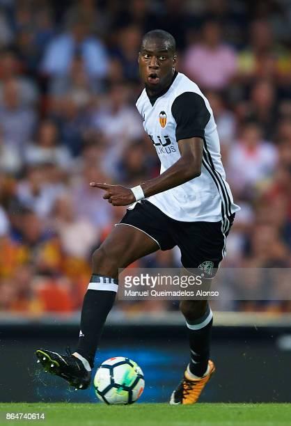 Geoffrey Kondogbia of Valencia runs with the ball during the La Liga match between Valencia and Sevilla at Estadio Mestalla on October 21 2017 in...