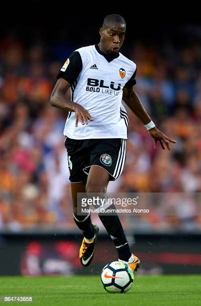 Geoffrey Kondogbia of Valencia runs with the ball during the La Liga match between Valencia and Sevilla at Estadio Mestalla on October 21 2017 in...