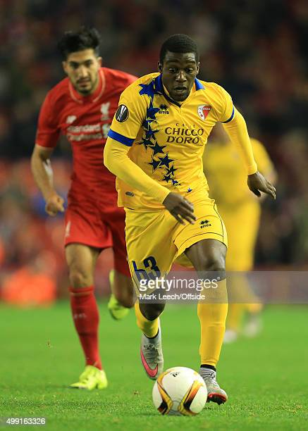 Geoffrey Mujangi Bia of Sion gets away from Emre Can of Liverpool during the UEFA Europa League Group B match between Liverpool and FC Sion on...