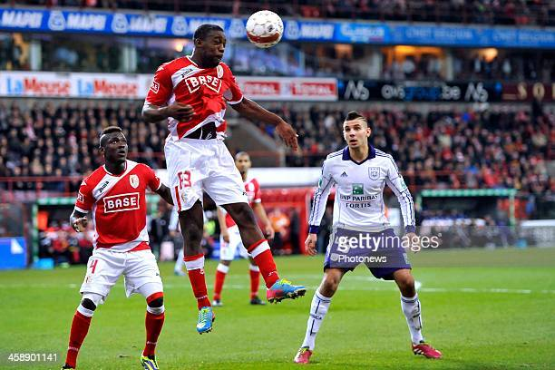 Geoffrey Mujangi Bia of Standard battles for the ball with Aleksandar Mitrovic of RSC Anderlecht during the Jupiler League match between Standard...