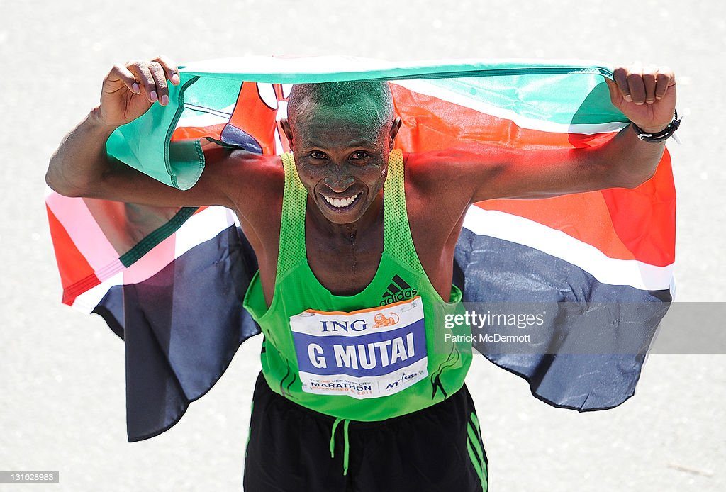 Geoffrey Mutai of Kenya celebrates after winning the Men's Division of the 42nd ING New York City Marathon in Central Park on November 6, 2011 in New York City.