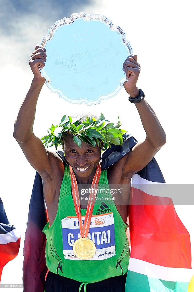 <a gi-track='captionPersonalityLinkClicked' href=/galleries/search?phrase=Geoffrey+Mutai&family=editorial&specificpeople=7119697 ng-click='$event.stopPropagation()'>Geoffrey Mutai</a> of Kenya celebrates after winning the Men's Division of the 42nd ING New York City Marathon on November 6, 2011 in New York City.