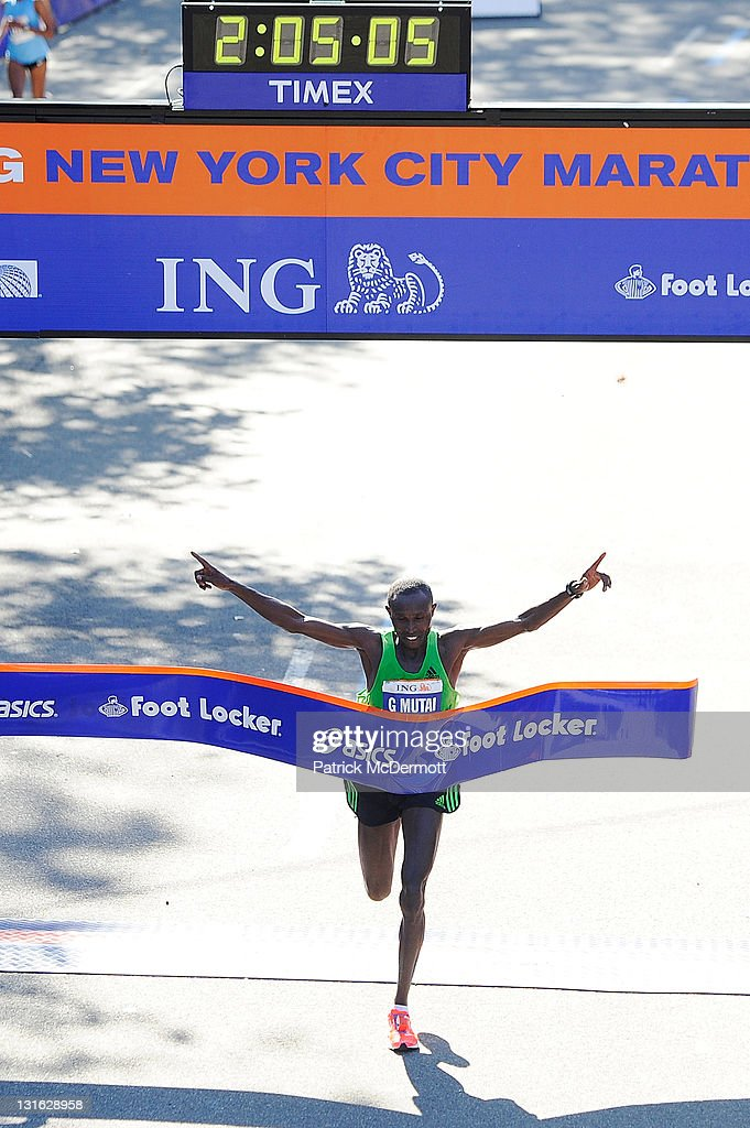 Geoffrey Mutai of Kenya celebrates as he wins the Men's Division of the 42nd ING New York City Marathon in Central Park on November 6, 2011 in New York City.