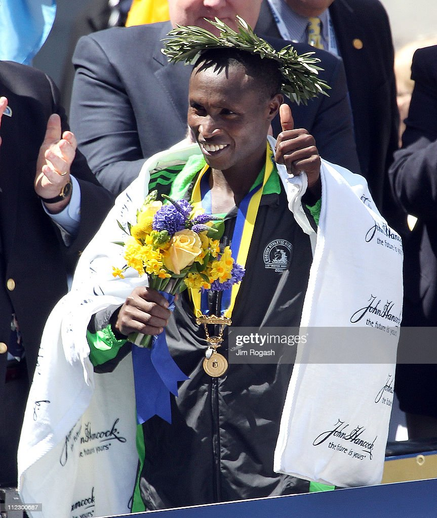 Geoffrey Mutai #2 of Kenya holds flowers after winning the men's division of the 115th running of the Boston Marathon on April 18, 2011 in Boston, Massachusetts.
