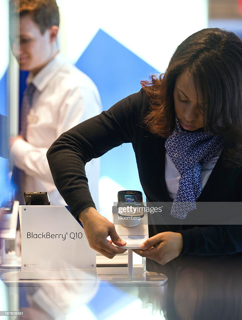 Geoffrey Newsome, sales consultant, left, and Diane Baxter, corporate store manager, prepare a BlackBerry Q10 display at a Bell Canada retail location in Toronto, Canada, on Tuesday, April 30, 2013. BlackBerry, the Canadian smartphone maker, climbed to its highest level in more than a month after Chief Executive Officer Thorsten Heins said he sees sales of its new Q10 device to be in the 'tens of millions.' Photographer: Galit Rodan/Bloomberg via Getty Images