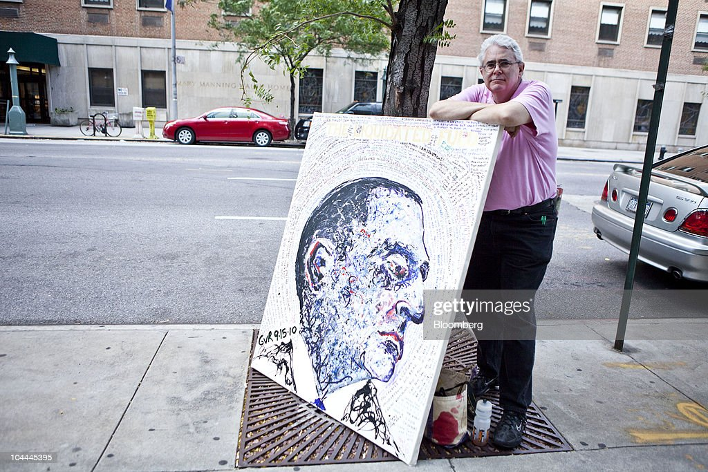 Geoffrey Raymond stands with one his paintings of Former Lehman Brothers Holdings Inc. Chief Executive Officer Richard Fuld, outside of Sotheby's in New York, U.S., on Saturday, Sept. 25, 2010. Artworks being auctioned from the collection of Lehman Brothers Holdings Inc. may raise another $16 million for its creditors as collectors and souvenir hunters snap up remains of the collapsed bank. Photographer: Ramin Talaie/Bloomberg via Getty Images