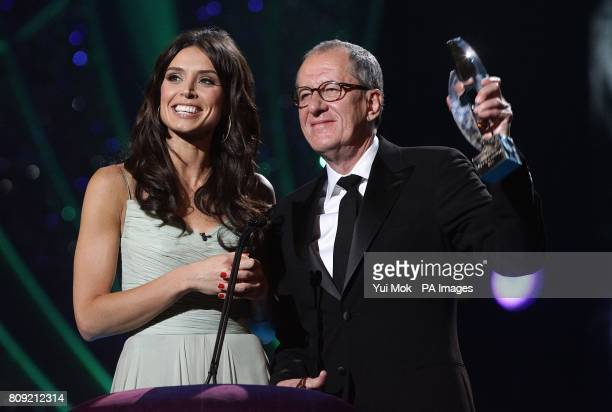 Geoffrey Rush collects the screen icon award on behalf of Johnny Depp with presenter Christine Bleakley during the 2011 National Movie Awards at...