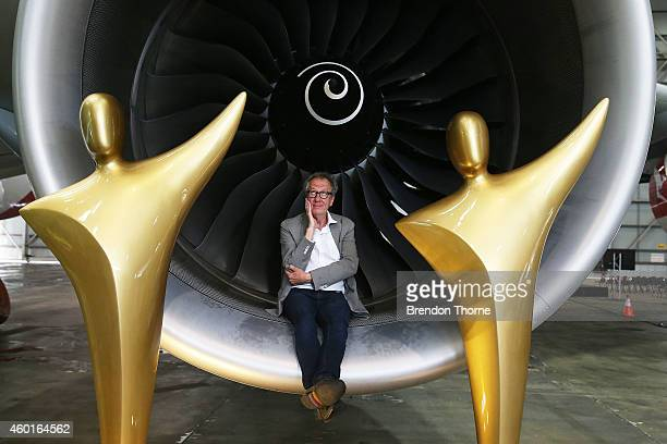 Geoffrey Rush poses with a lifesize AACTA statuettes inside the engine of a Qantas Airbus A380 at Hangar 416 Sydney Jetbase Sydney Airport on...