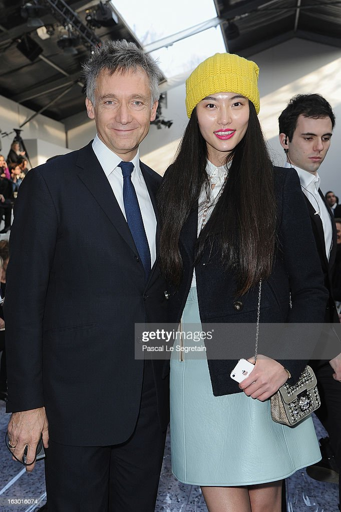 Geoffroy de la Bourdonnaye (L) and <a gi-track='captionPersonalityLinkClicked' href=/galleries/search?phrase=Bonnie+Chen&family=editorial&specificpeople=7185356 ng-click='$event.stopPropagation()'>Bonnie Chen</a> attend the Chloe Fall/Winter 2013 Ready-to-Wear show as part of Paris Fashion Week on March 3, 2013 in Paris, France.