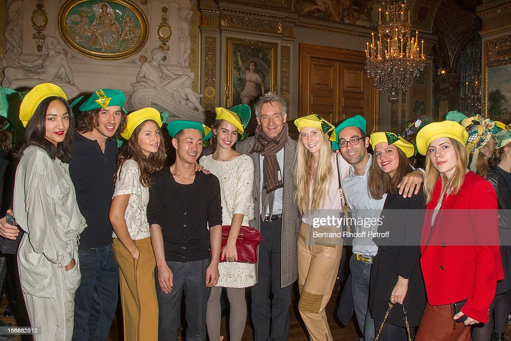 Geoffroy de la Bourdonnaye (C), CEO of Chloe fashion house, poses with young employees of Chloe at the Paris City Hall during the Sainte-Catherine Celebration on November 23, 2012 in Paris, France.