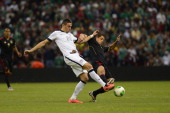Geofrey Cameron of the United States fights for the ball with Javier Hernandez of Mexico during a match between Mexico and USA as part of the...
