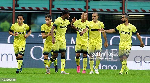 Geofrey Kondogbia of FC Internazionale celebrates his first goal with his team players during the Berlusconi Trophy match between AC Milan and FC...