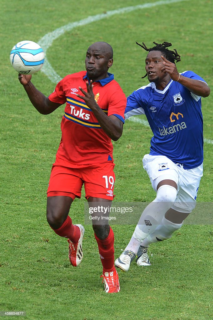 Geofrey Massa of Tuks and Mbulelo Mabizela of Aces during the Absa Premiership match between University of Pretoria and Black Aces at Tuks Stadium on December 22, 2013 in Pretoria, South Africa. (Photo by Lefty Shivambu/Gallo Images/Getty Images)Getty Images)