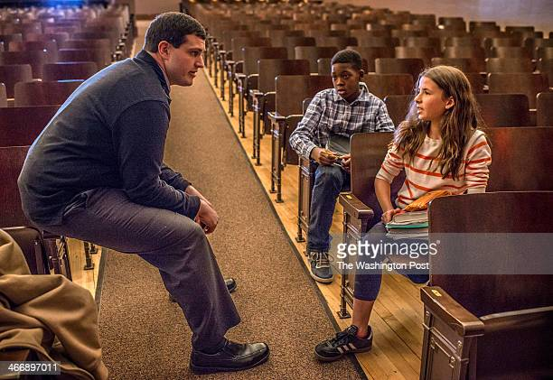 Geography teacher Michael Martini left talks with students Xzavier Long center and Eliza Dahlkemper right before homeless people arrive to address...