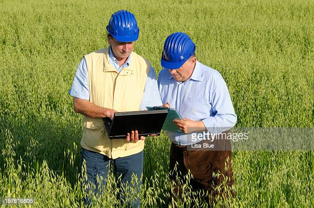 Geologist and Engineer with Laptop in the Countryside