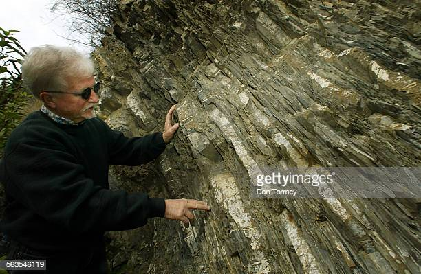 Geologist John Cooper Professor Emeritus from California State University at Fullerton shows the deformation of exposed rock layers in the canyon...