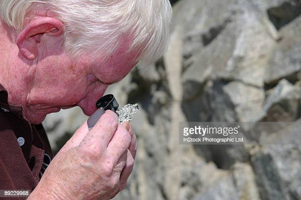 Geologist with Loupe