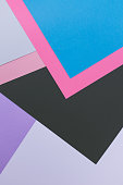 geometric background of colored paper pieces.