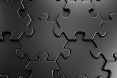 Close-up view of assembled hexagonal parts of black colored jigsaw puzzle. 3d rendering graphics.