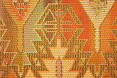 Navajo styled design in woven fabric Southwestern pattern.