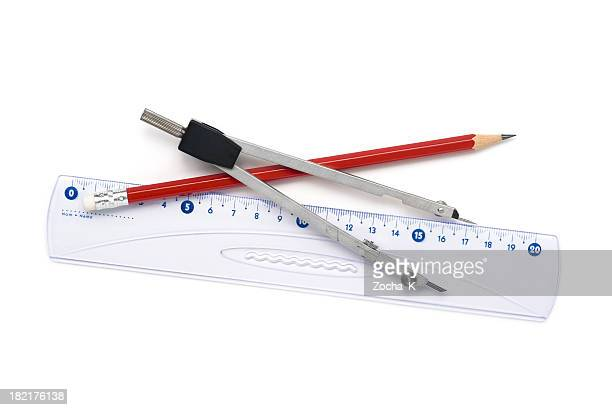 Geometry compass, ruler and red pencil on white background