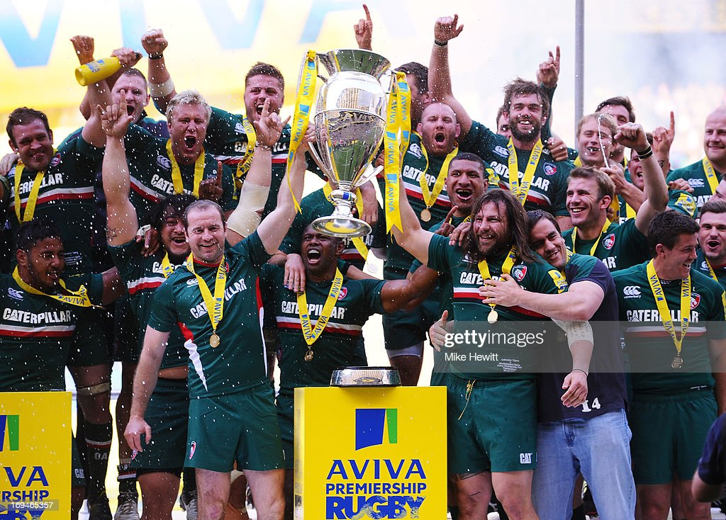 Geordan Murphy (L) and Martin Castrogiovanni (R) of Leicester lift the trophy following their team's 37 - 17 victory during the Aviva Premiership Final between Leicester Tigers and Northampton Saints at Twickenham Stadium on May 25, 2013 in London, England.