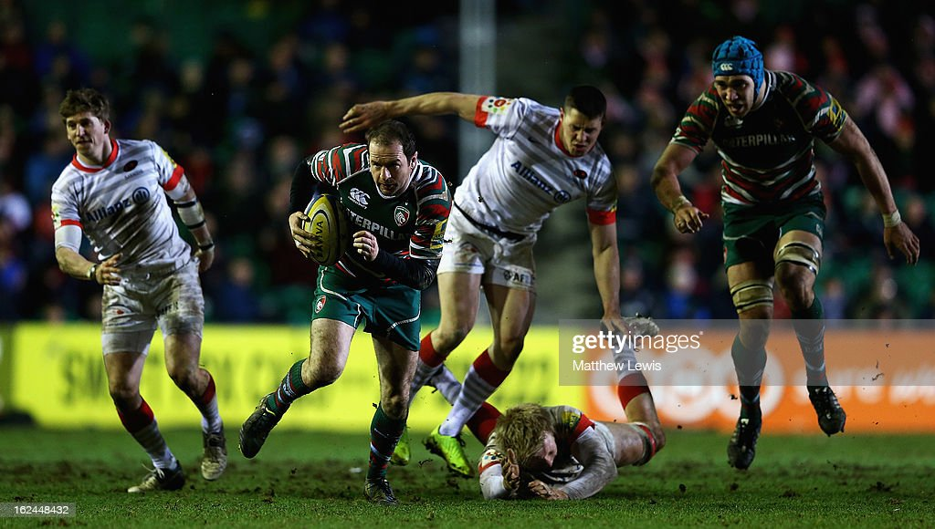 <a gi-track='captionPersonalityLinkClicked' href=/galleries/search?phrase=Geordan+Murphy+-+Rugby+Player&family=editorial&specificpeople=215157 ng-click='$event.stopPropagation()'>Geordan Murphy</a> of Leicester slips through the Saracens defence during the Aviva Premiership match between Leicester Tigers and Saracens at Welford Road on February 23, 2013 in Leicester, England.