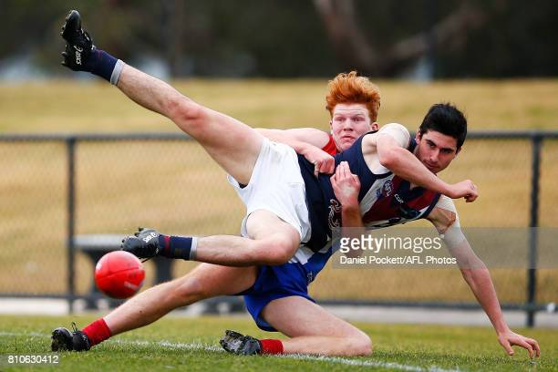 Geordie Nagle of the Dragons is tackled by Kyle Reid of the Power during the round 12 TAC Cup match between Gippsland and Sandringham at Casey Fields...