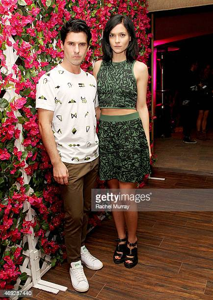 Geordon Nicol and Leigh Lezark of The Misshapes attend the NYLON Midnight Garden Party at a private residence on April 10 2015 in Bermuda Dunes...