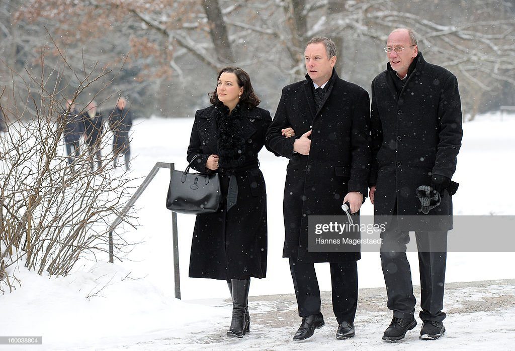 Georg Fahrenschon and his wife and Hans-Georg Kueppers (L) attend the memorial service for Steffen Kuchenreuther at the Waldfriedhof on January 25, 2013 in Munich, Germany.