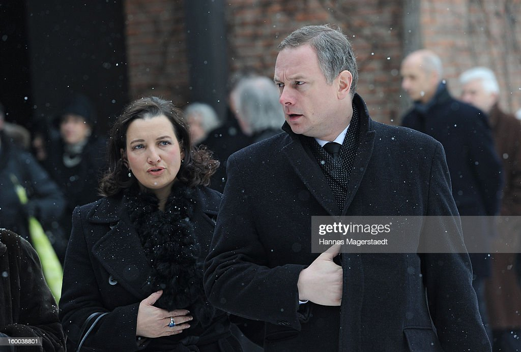 Georg Fahrenschon and his wife attend the memorial service for Steffen Kuchenreuther at the Waldfriedhof on January 25, 2013 in Munich, Germany.