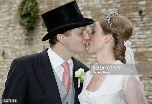 Georg Friedrich Ferdinand Prince of Prussia kisses his wife Princess Sophie of Prussia as they leave their religious wedding ceremony in the...