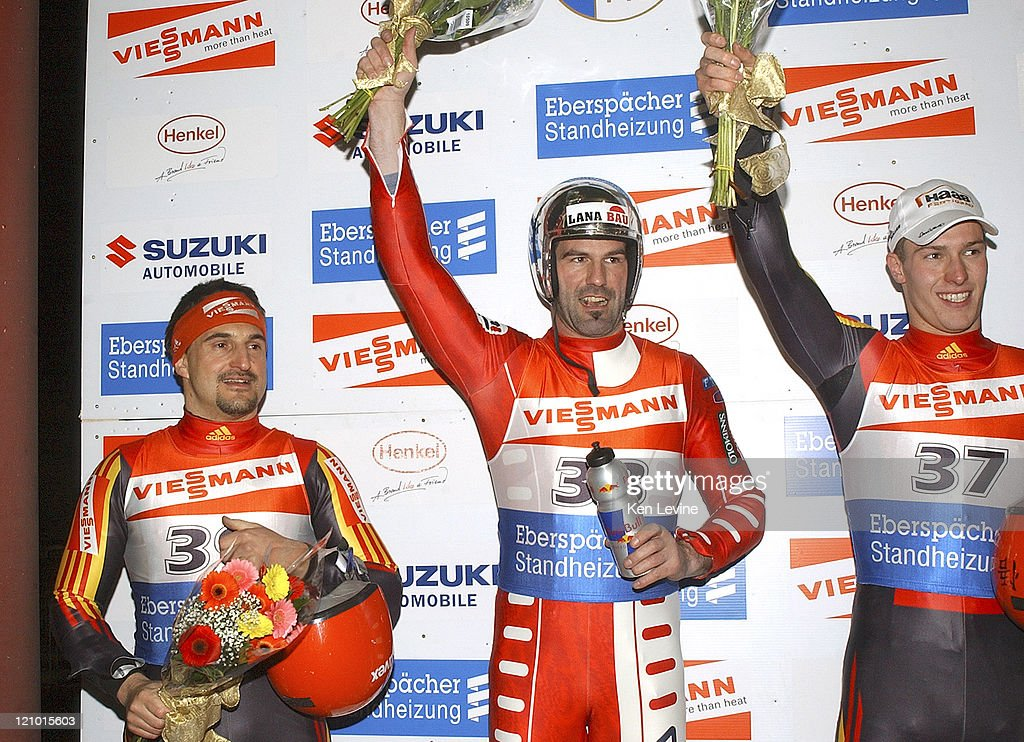 Georg Hackl, of Germany, finished second to 2005 Luge World Champions Armin Zoggeler, of Italy, and David Moeller, also of Germany finished third at the Utah Olympic Park in Park City, Utah, Saturday Feb. 19, 2005.