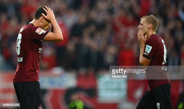 Georg Margreitter and Hanno Behrens of Nuernberg regret a missed goal chance during the Second Bundesliga match between 1 FC Nuernberg and 1 FC...