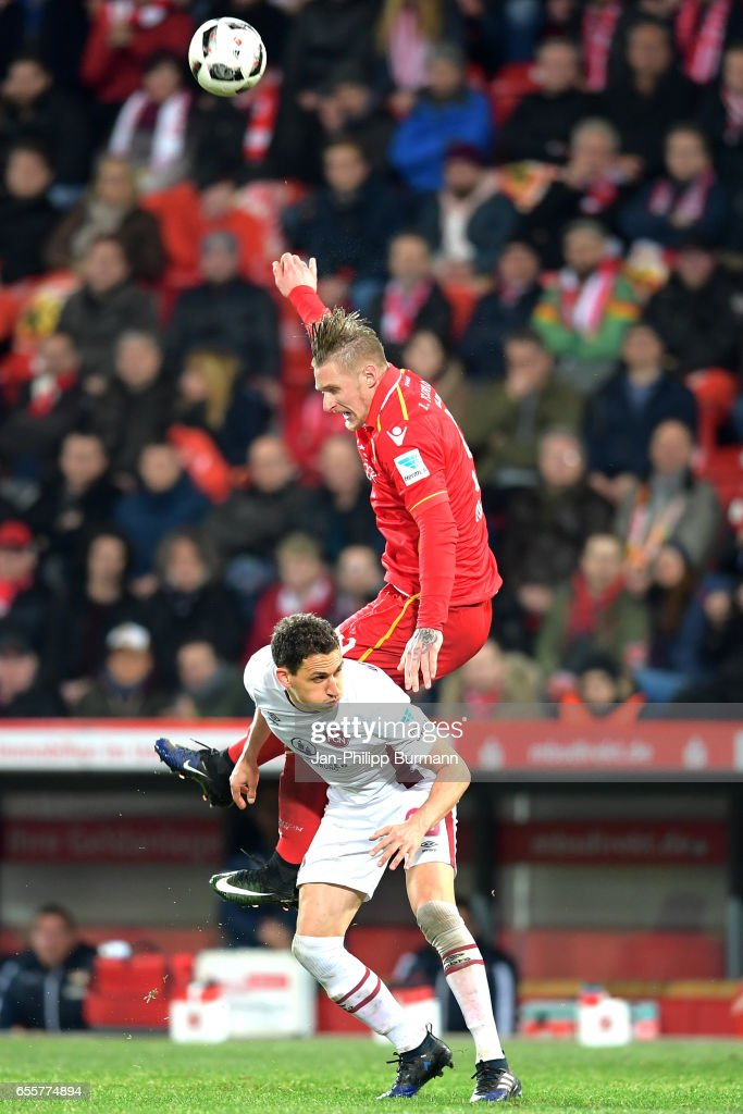 Georg Margreitter of 1. FC Nuernberg and Sebastian Polter of 1.FC Union Berlin during the game between 1 FC Union Berlin and 1 FC Nuernberg on March 20, 2017 in Berlin, Germany.