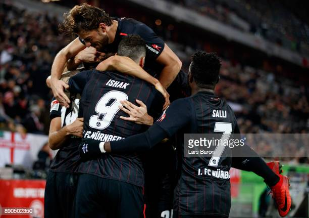 Georg Margreitter of Nuernberg celebrates with team mates after scoring his teams second goal during the Second Bundesliga match between Fortuna...